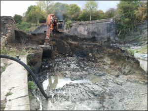 Digging Out The Canal Arm